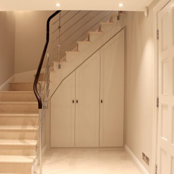 two entrances- two floors- contemporary concrete stairs clad with stone